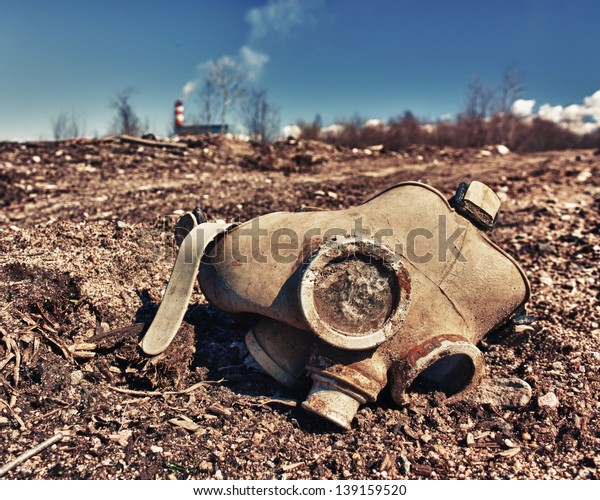 Old gas mask lies on the road.