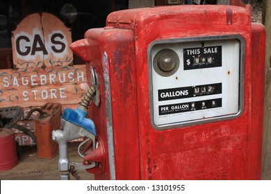 An old gas pump used as a movie prop.