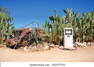 Old gas station with wreck of car