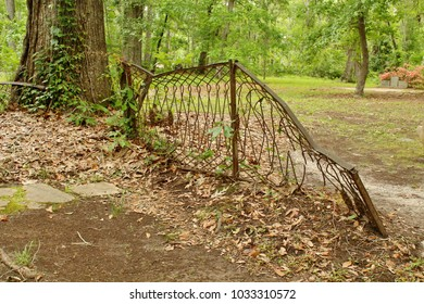 Old gate, broken and falling down with age
