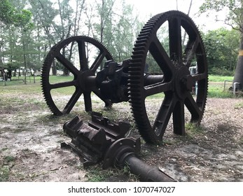 Old gear of mining boat on the ground, Old big gear
