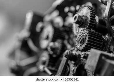 Old gears in black oil. Black and white