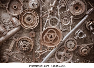 Old gears, spare parts from the car, rusty iron. Rough texture, grunge. Corrosion of metal. Warm tinting, vignetting.