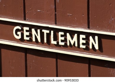 Old Gentlemen Sign At A Train Station