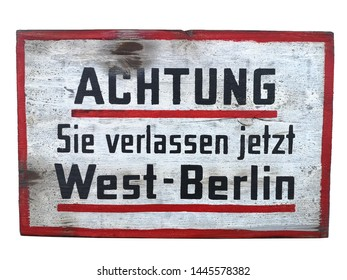 old german DDR wood shield road sign on white backround Achtung Sie verlassen West Berlin it means attention you will leave Berlin the capital of germany