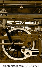Old german steam locomotive, built in 1940, in a museum. The heaviest locomotive, 85 tons, that circulated in Romania during the Second World War. Detail and close up of huge wheels. Sepia processing.