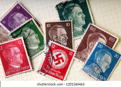Old German Third Reich postage stamps from the second world war with Adolph Hitler and the Nazi Swastika.