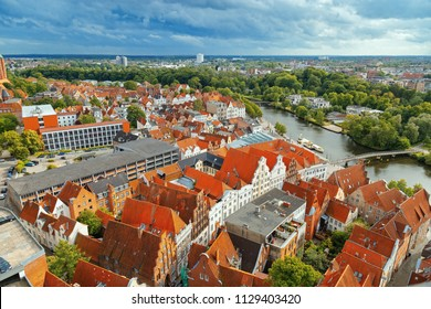 Old German town of Lubeck on river Trave. Panorama of small town. Medieval Gothic extensive Brick Gothic architecture in Germany. Top veiw.  June 2017.