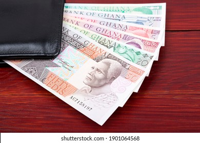 Old Ghanaian Cedis in the black wallet