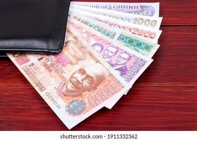 Old Ghanaian money in the black wallet