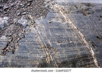 Old glacier movement erosion detail in a rock, Alaska