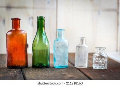 Old glass bottles. Closeup, daylight
