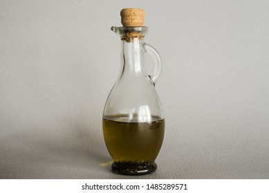 Old glass carafe with oil.