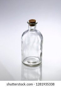old glass pharmacy bottle with cork