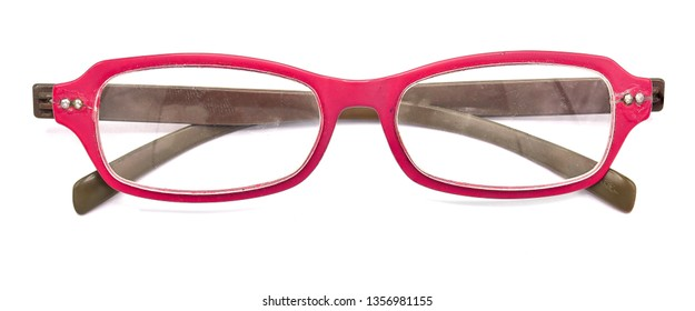 Old glasses with plastic box on the white background