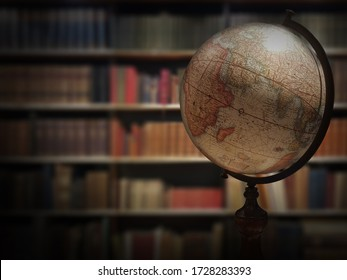 Old globe near bookshelves, ancient library