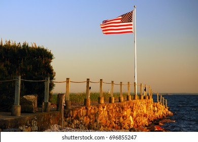 Old Glory waves on the waterfront at the day's end
