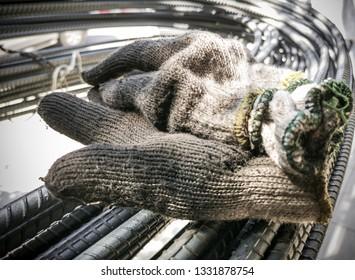 Old glove on steel bar