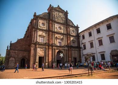 OLD GOA, INDIA - DECEMBER 27, 2018: Unidentified tourists visit the famous landmark - Basilica of Bom Jesus (Borea Jezuchi Bajilika) in Old Goa, India. Basilica is a UNESCO World Heritage Site.