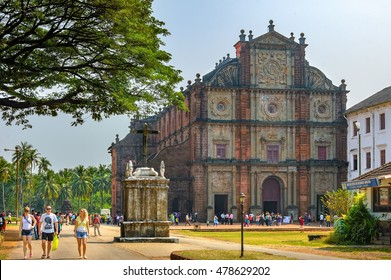 Old Goa, India -  November 13, 2012: Unidentified tourists visit to the famous landmark - Basilica of Bom Jesus (Borea Jezuchi Bajilika) in Old Goa, India. Basilica is a UNESCO World Heritage Site.