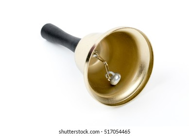 Old gold vintage school bell,hand bell made of brass with wooden handle isolated on a white background.Retro hotel bell on a white background.  Service call. Christmas decor