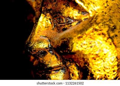 old golden Buddha figure