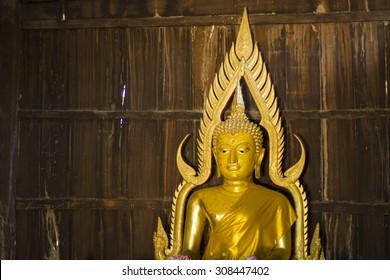 The old Golden Buddha in thailand temple - public temple - wood wall Golden buddha at ubosot Temple on Buddhist holy day