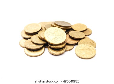 Old golden coins stack isolated on white background