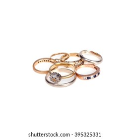 Old golden rings on white background