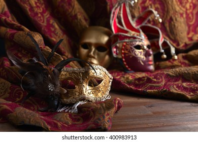 Old golden Venetian masks , focus on  foreground