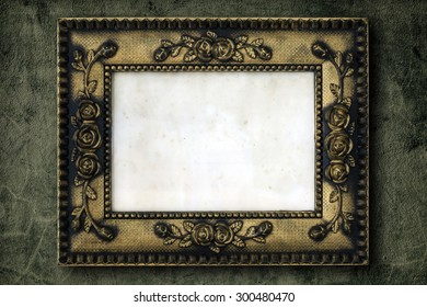 Old golden wood photo frame on cement wall background