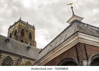 Old gothic church and bell tower with an overcast sky