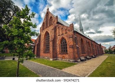 Old Gothic church Klosterkirken in Horsens, Denmark, in summer day