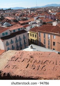 Old grafitti (1916) on a tower overviewing the city of Perpignan in the south of France (vertical)