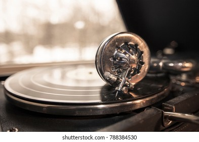 Old gramophone with a plate