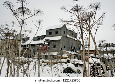 old granary covered with snow on a winter day