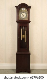 An old grand-daughter clock standing against the wall.