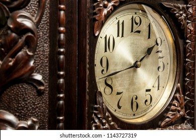 An old grandfather clock on a fancy room. Close up.