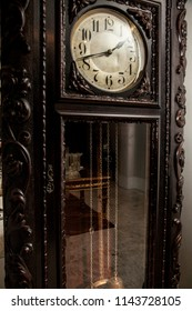 An old grandfather clock on a fancy room.