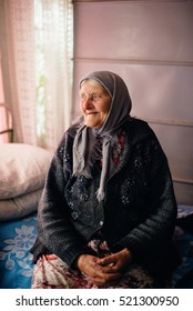 The old grandmother at home in Russian village
