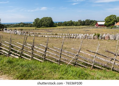 An old grave site from the Bronze Age in the fields by a farm on the Swedish island of Gotland on a beautiful summer day.