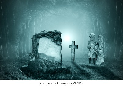 Old graves in a forest at night