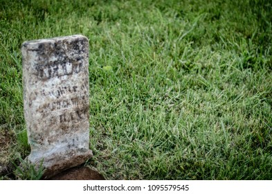 old gravestone in a historic cemetery - landscape