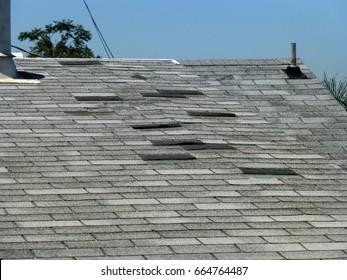 Old gray asphalt roof