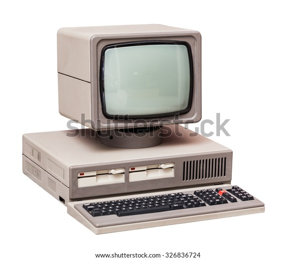 Old gray computer isolated on a white background
