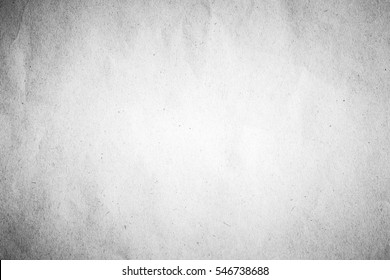 Old gray crumpled drawing paper kraft background texture in soft white light color concept for table top view packaging wallpaper bacground desk, rice matte surface organic pattern for simple wall.
