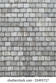 Old gray roof slates close up.