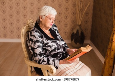 The old gray-haired woman reading a book