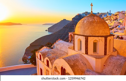 Old greek church in Thira town and Aegean sea at sundown, Santorini, Greece