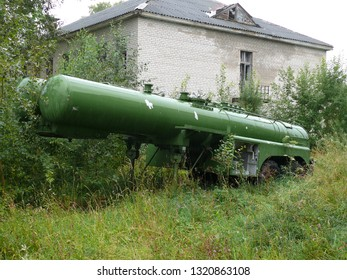 Old green abandoned trailer - tank for transportation of rocket fuel in an abandoned industrial area after an emergency evacuation